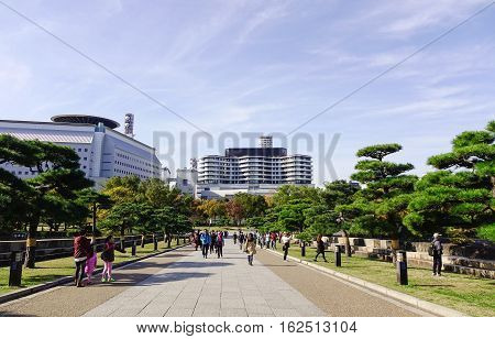 People Walking At The City Park In Osaka