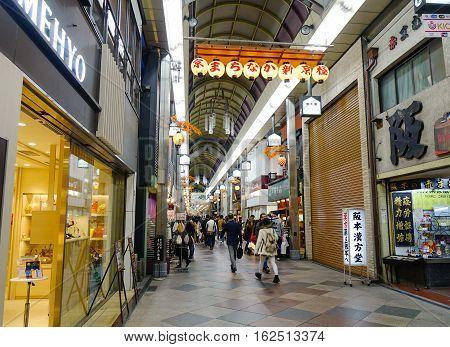 People Walking At Night Market In Kyoto