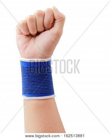 Close up of right female hand - raised up clenched fist with blue wrist support isolated over white background clipping path.