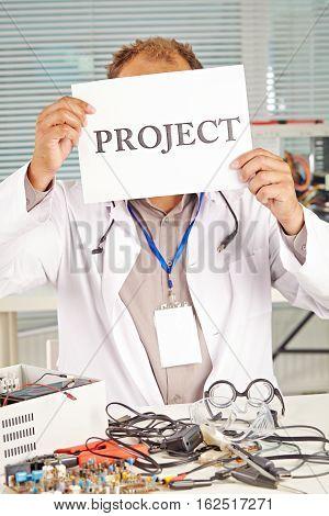 scientist making his new machine in lab