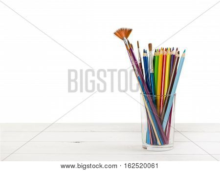 Colored Pencils And Brushes To Draw In Glass