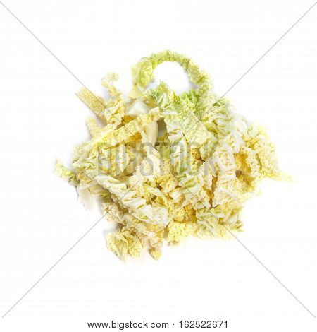 Chopped leaves of savoy cabbage on a white background