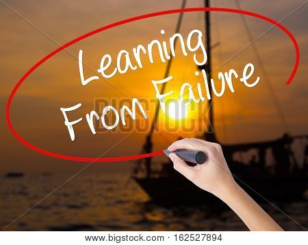 Woman Hand Writing Learning From Failure With A Marker Over Transparent Board.