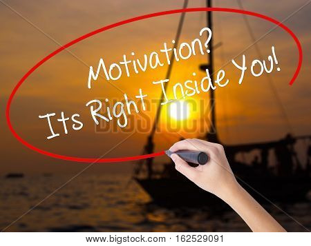 Woman Hand Writing Motivation? Its Right Inside You!  With A Marker Over Transparent Board