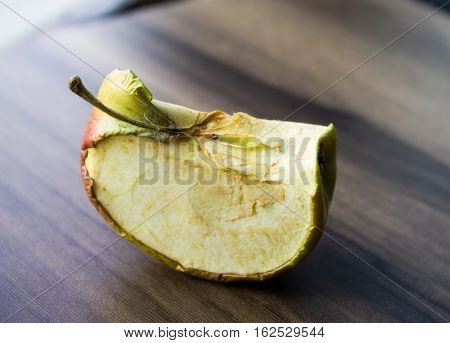 the dried-up apple on a wooden board can be used for design