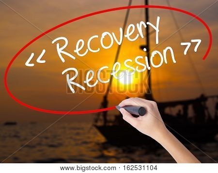 Woman Hand Writing  Recovery - Recession With A Marker Over Transparent Board