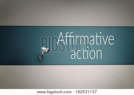 Affirmative action text on the wall with surveillance camera.