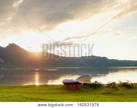 Fishing Paddle Boat And Upside Down Paddle Boat  On Bank Of Alps Lake.