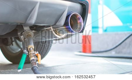 Fuel gas station and car fuel empty concept - Rear view of car refuel LPG CNG gas in gasoline station for car and copy space