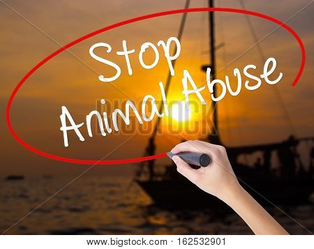 Woman Hand Writing Stop Animal Abuse With A Marker Over Transparent Board