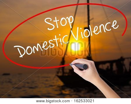 Woman Hand Writing  Stop Domestic Violence With A Marker Over Transparent Board