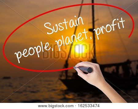 Woman Hand Writing Sustain, People, Planet, Profit With A Marker Over Transparent Board