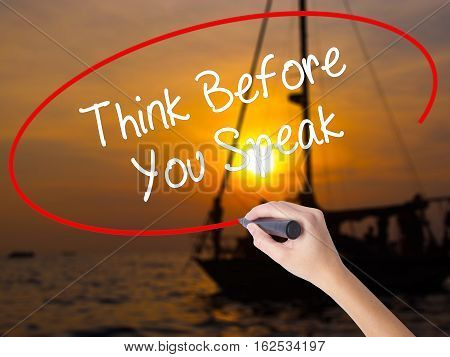 Woman Hand Writing Think Before You Speak With A Marker Over Transparent Board