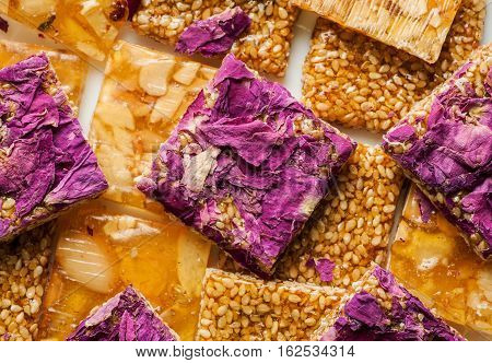 Close-up Shot Of Sweets With Rose Petals, Seeds And Nuts