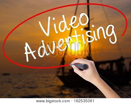 Woman Hand Writing Video Advertising With A Marker Over Transparent Board