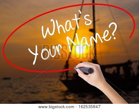 Woman Hand Writing What's Your Name? With A Marker Over Transparent Board