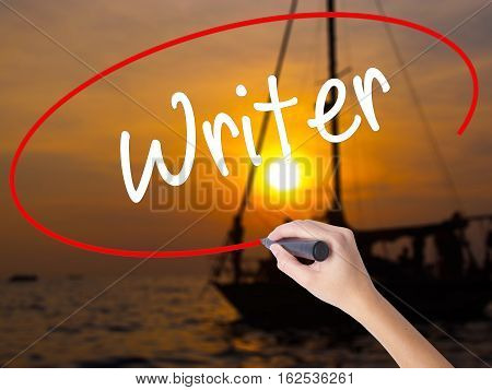 Woman Hand Writing Writer With A Marker Over Transparent Board