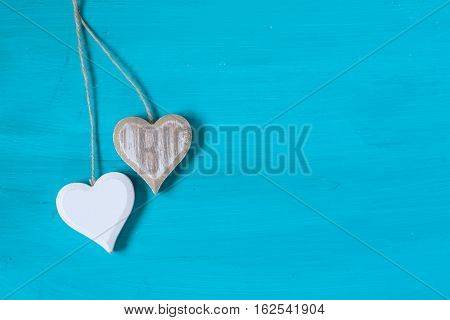 wooden hearts on a blue wooden background