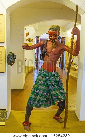 AMBALANGODA SRI LANKA - DECEMBER 5 2016: The figure of dancer in traditional mask in Mask Museum on December 5 in Ambalangoda.