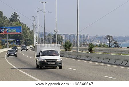 Sochi Russia - August 26 2016: people are riding in cars by viaduct over Khosta district in the Greater Sochi Russia