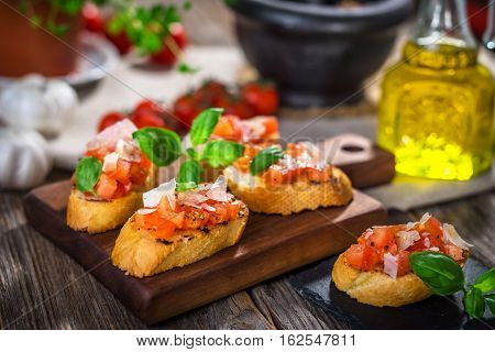 Tasty Bruschetta With Tomato,  Basil, Parmesan, Olive Oil ...