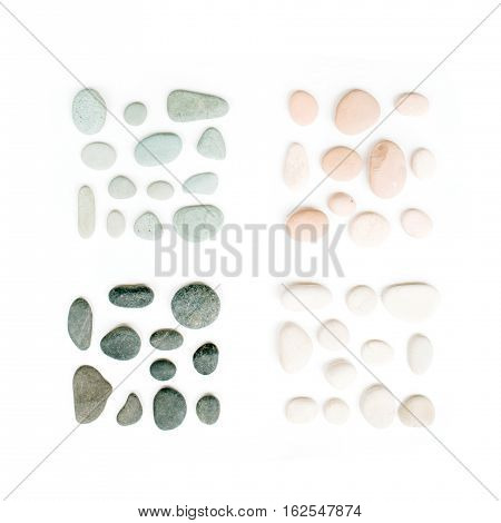 Creative arrangement of colored stones. Mint pink beige and grey stones on white. Flat lay top view