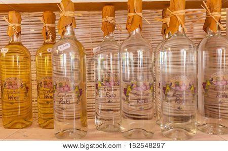 Agios Nikolaos, Greece - July 29, 2012:  Wine And Brandy Rakia Of Home Manufacture