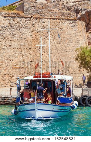 Spinalonga, Greece - July 31, 2012:  The Excursion Boat Took A Group Of Tourists To Visit  Spinalong