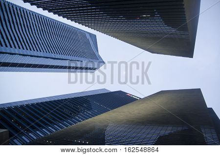 Modern transperent background perspective view to steel blue glass high rise building skyscrapers, industrial architecture