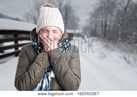 Young Female Outdoors Sneezing