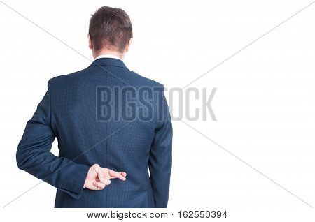 Back View Of Business Man Showing Fingers Crossed