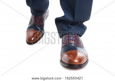 Close-up Of Man Designer Shoes In Walking Position