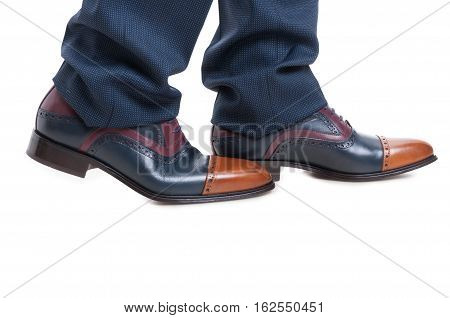 Close-up Of Man Shoes And Trousers In Walking Position