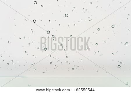 clean round water drops on transparent glass, closeup background photo