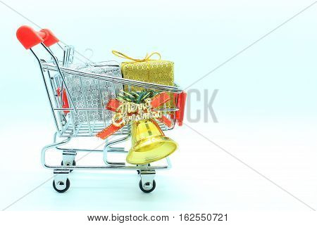 single supermarket trolley with two gift boxs and golden bell for use in decorating the Christmas and New Year's Day. or can be used with shopping at the supermarket in other special days.