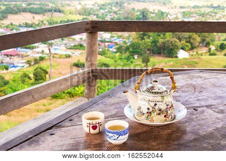 Chinese Style Teacup And Teapot With Green Tea