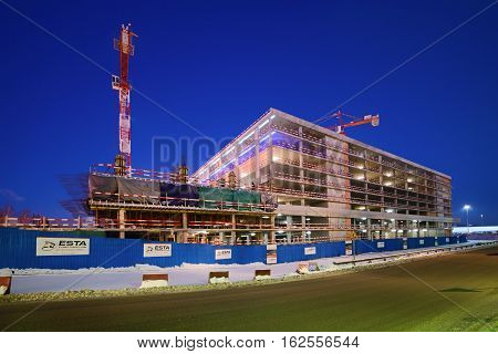 Moscow region, Domodedovo, Russia - December 15, 2016: Construction of multi-level car parking on the territory of the international airport Domodedovo. Winter, Night Scene.