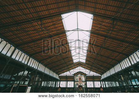 BARCELONA SPAIN - JUNE 2 2016. View from inside of cultural center El Born. Old City Market museum roof with people inside captured on wide angle lens