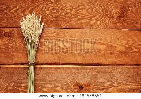 Wooden Natural Rufous Background With Wheat Sheaf