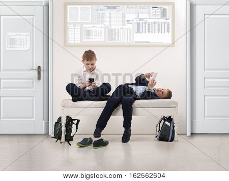 Boys play phones in a public institution - a school or clinic