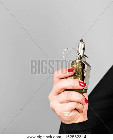 Hand grenade in a young woman's hand.