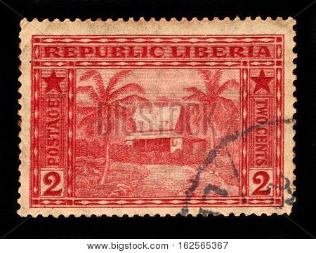 Liberia - CIRCA 1915: A stamp printed in Liberia shows liberian house, circa 1915