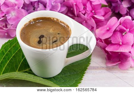 Cup Of Coffee And Hortensia Flowers