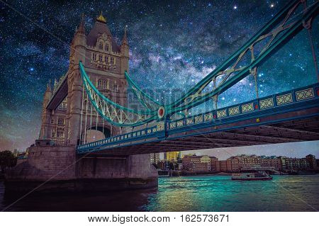 Landscape with Milky way galaxy. Night sky with stars over Tower Bridge at London UK.
