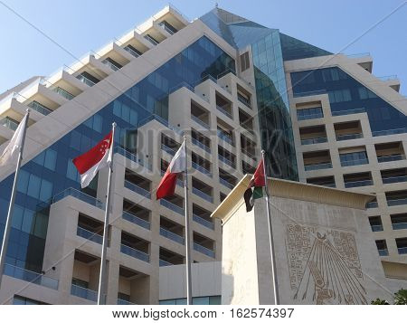 DUBAI, UAE - NOV 26: Raffles Hotel in Dubai, UAE, as seen on Nov 26, 2016. It is a 19-storey hotel that is built in the shape of a pyramid. The design was an inspiration taken from traditional Egyptian architecture.