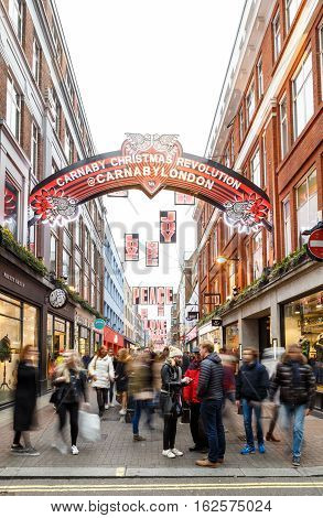 LONDON ENGLAND - DECEMBER 17: 'Carnaby Christmas Revolution' and tourists on Carnaby Street London. In London England. On 17th December 2016.