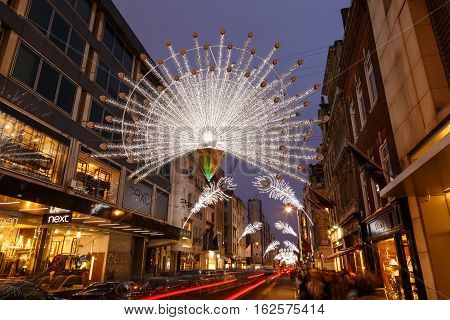 LONDON ENGLAND - DECEMBER 17: Christmas lights and decorations on New Bond Street London. In London England. On 17th December 2016.