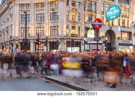 LONDON ENGLAND - DECEMBER 17: Blurred people Christmas Shopping at Oxford Circus London. In London England. On 17th December 2016.