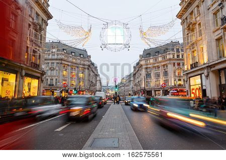 LONDON ENGLAND - DECEMBER 17: Christmas lights and decorations on Regent Street London. In London England. On 17th December 2016.