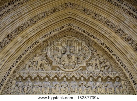 Detail of old church facade. Architectural detail with Jesus Christ His apostles and angels.